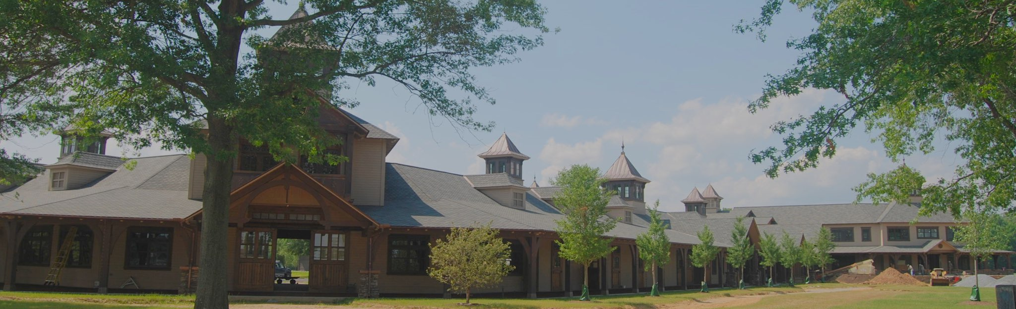 Exterior of beautiful, sprawling equestrian building by Engel Architects